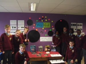 Students with a display of books about space.
